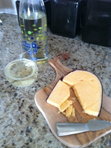 The gouda back at home with some moscato from an Indiana winery.