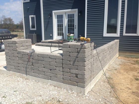 Proof of this attitude?  His landscaping project of the day was creating this beautiful wall for our patio.  So happy to give it a little character.